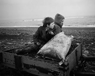 """Rocker"" and Rosie Going Home, Seacoal Beach, Lynemouth, Northumberland, 1983, Chris Killip, gelatin silver print. The J. Paul Getty Museum, gift of the Robert Mapplethorpe Foundation, Inc.  © Chris Killip."