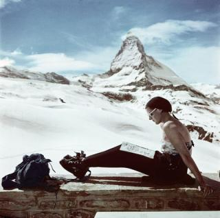 Zermatt. SWITZERLAND. 1950. Skier sunbathing in front of the Matterhorn. © Robert Capa © International Center of Photography/Magnum Photos